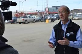 Senator Hollis French talks with the media about the effort to repeal the Oil Giveaway